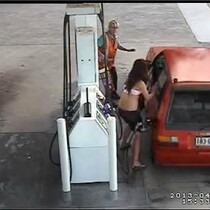 Barely Dressed (Not attractive) woman has a bad day when her and her boyfriend fail miserably at stealing gas...