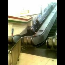 Drunk Guy Trying to Walk Up An Escalator