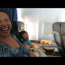 WATCH THIS! Kid falls asleep while eating...on an airplane. LOL!
