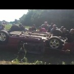 15 People Flip Over An Overturned Car to Save a Man's Life!