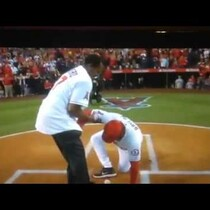 Don Baylor breaks leg catching a first pitch