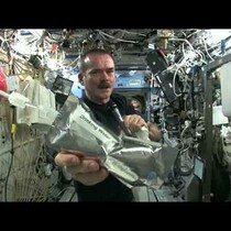 What happens when you wring out a wet towel in outer space? Probably not what you think. Watch!