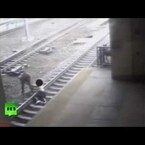 Cop saves man from train, by seconds (video)