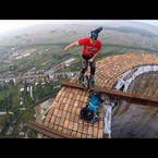 Guy Rides Unicycle On Top Of 840ft Chimney