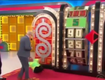 Woman with custom Drew Carey nails, eats it on the price is right!