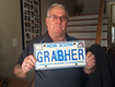 A guy with the last name Grabher wants to keep his plate!