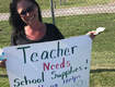 Teacher Begs on Street Corner for Classroom Supply Money