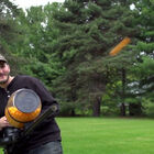 VIDEO: If You're Not Pelting Your Kids With This Cheese Ball Machine Gun You're Parenting Wrong