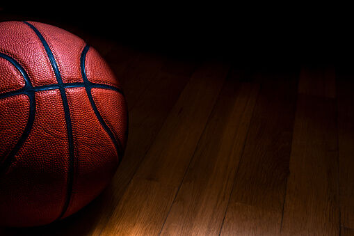 Close-Up Of Basketball On Hardwood Floor