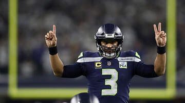Seattle - Sports - Russell Wilson gifts $12,000 in Amazon stock to his 13 offensive linemen