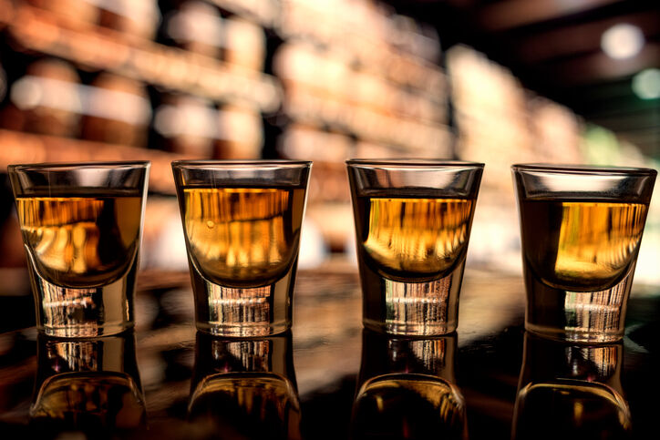 Close-Up Of Shot Glasses - GettyImages-763268411