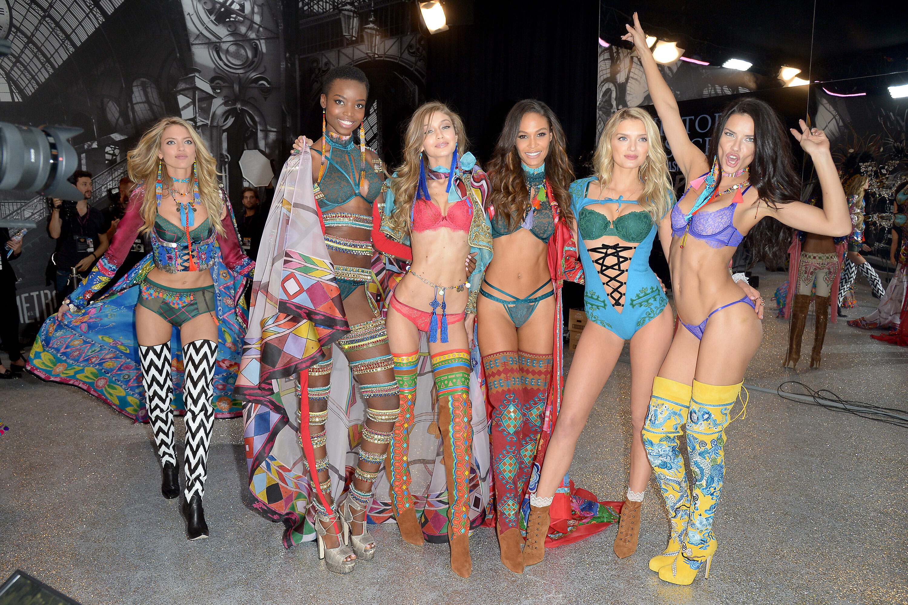 PARIS, FRANCE - NOVEMBER 30:  (L-R) Martha Hunt, Maria Borges, Gigi Hadid, Joan Smalls, Lily Donaldson and Adriana Lima poses backstage during the Victoria's Secret Fashion Show on November 30, 2016 in Paris, France.  (Photo by Dominique Charriau/Getty Im