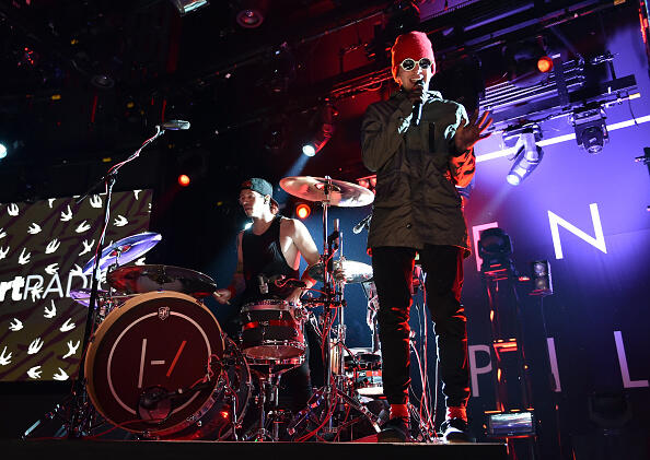 BURBANK, CA - MAY 19:  Musicians Josh Dun (L) and Tyler Joseph of Twenty One Pilots perform onstage during the iHeartRadio Live Series with Twenty One Pilots at the iHeartRadio Theater LA on May 19, 2015 in Burbank, California.  (Photo by Kevin Winter/Getty Images for iHeartMedia)