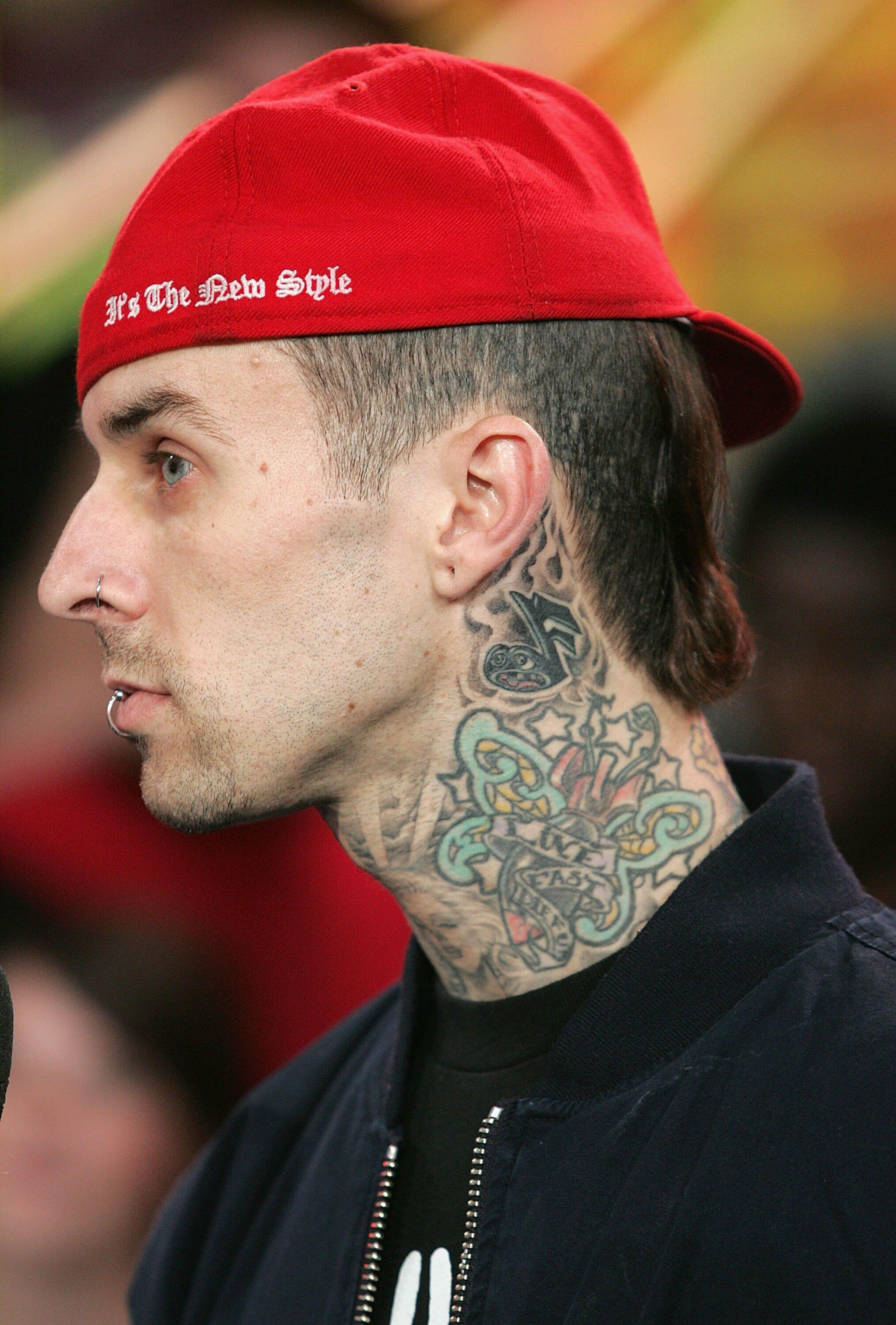 NEW YORK - NOVEMBER 17:  (U.S. TABS OUT) Musician Travis Barker of the group (+44) appears onstage during MTV's Total Request Live at the MTV Times Square Studios on November 17, 2006 in New York City.  (Photo by Peter Kramer/Getty Images)