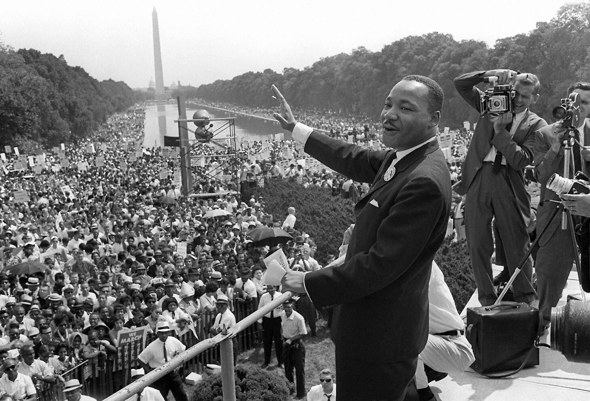 WASHINGTON, UNITED STATES:  (FILES) US civil rights leader Martin Luther King, Jr., waves to supporters from the steps of the Lincoln Memorial 28 August, 1963, on The Mall in Washington, DC, during the