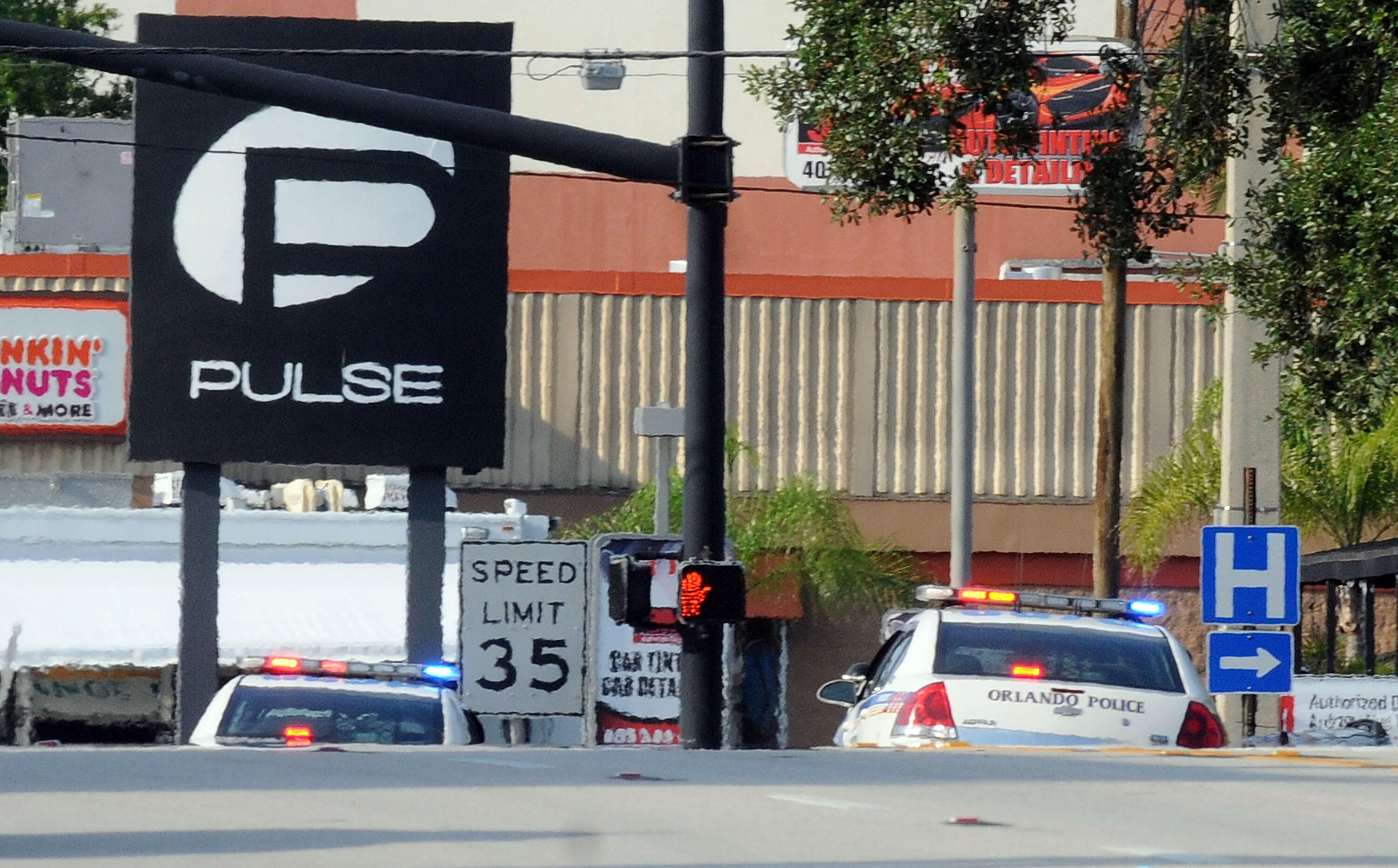 ORLANDO, FL - JUNE 12:  Orlando police officers seen outside of Pulse nightclub after a fatal shooting and hostage situation on June 12, 2016 in Orlando, Florida. The suspect was shot and killed by police after 20 people died and 42 were injured. (Photo b
