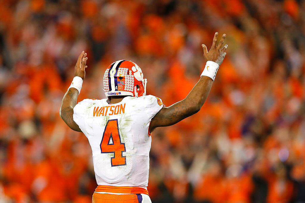 TAMPA, FL - JANUARY 09:  Quarterback Deshaun Watson #4 of the Clemson Tigers reacts after a touchdown by running back Wayne Gallman #9 (not pictured) during the fourth quarter against the Alabama Crimson Tide in the 2017 College Football Playoff National Championship Game at Raymond James Stadium on January 9, 2017 in Tampa, Florida.  (Photo by Kevin C. Cox/Getty Images)