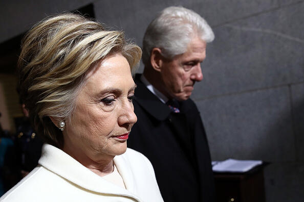 WASHINGTON, DC - JANUARY 20:  Former Democratic presidential nominee Hillary Clinton (L) and former President Bill Clinton arrive on the West Front of the U.S. Capitol on January 20, 2017 in Washington, DC. In today's inauguration ceremony Donald J. Trump becomes the 45th president of the United States.  (Photo by Win McNamee/Getty Images)