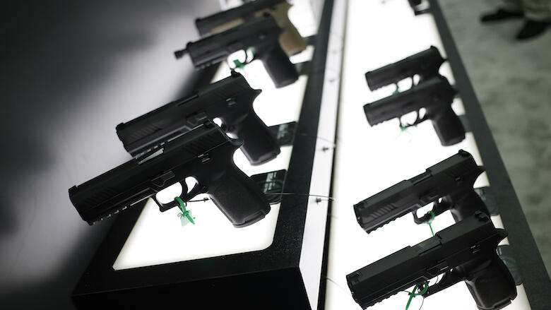SIG P320 handguns are displayed at the SIG Sauer GmbH booth on the exhibit floor during the National Rifle Association (NRA) annual meeting in Louisville, Kentucky, U.S., on Friday, May 20, 2016. The nation's largest gun lobby, the NRA has been a politica
