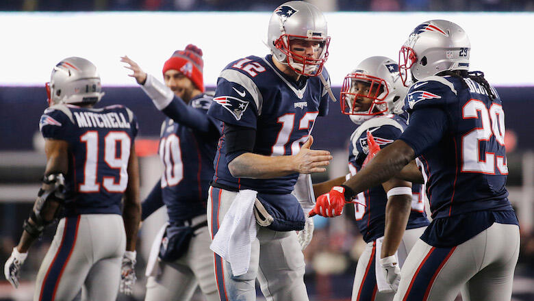 FOXBORO, MA - JANUARY 22:  Tom Brady #12 of the New England Patriots celebrates with LeGarrette Blount #29 after throwing a touchdown pass to Julian Edelman #11 (not pictured) during the third quarter against the Pittsburgh Steelers in the AFC Championshi