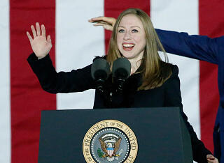 Chelsea Clinton speaks as her father former US President Bill Clinton gestures to the crowd during a rally for his wife Democratic presidential candidate Hillary Clinton on the final night of the 2016 US presidential campaign at Independence Mall in Phila