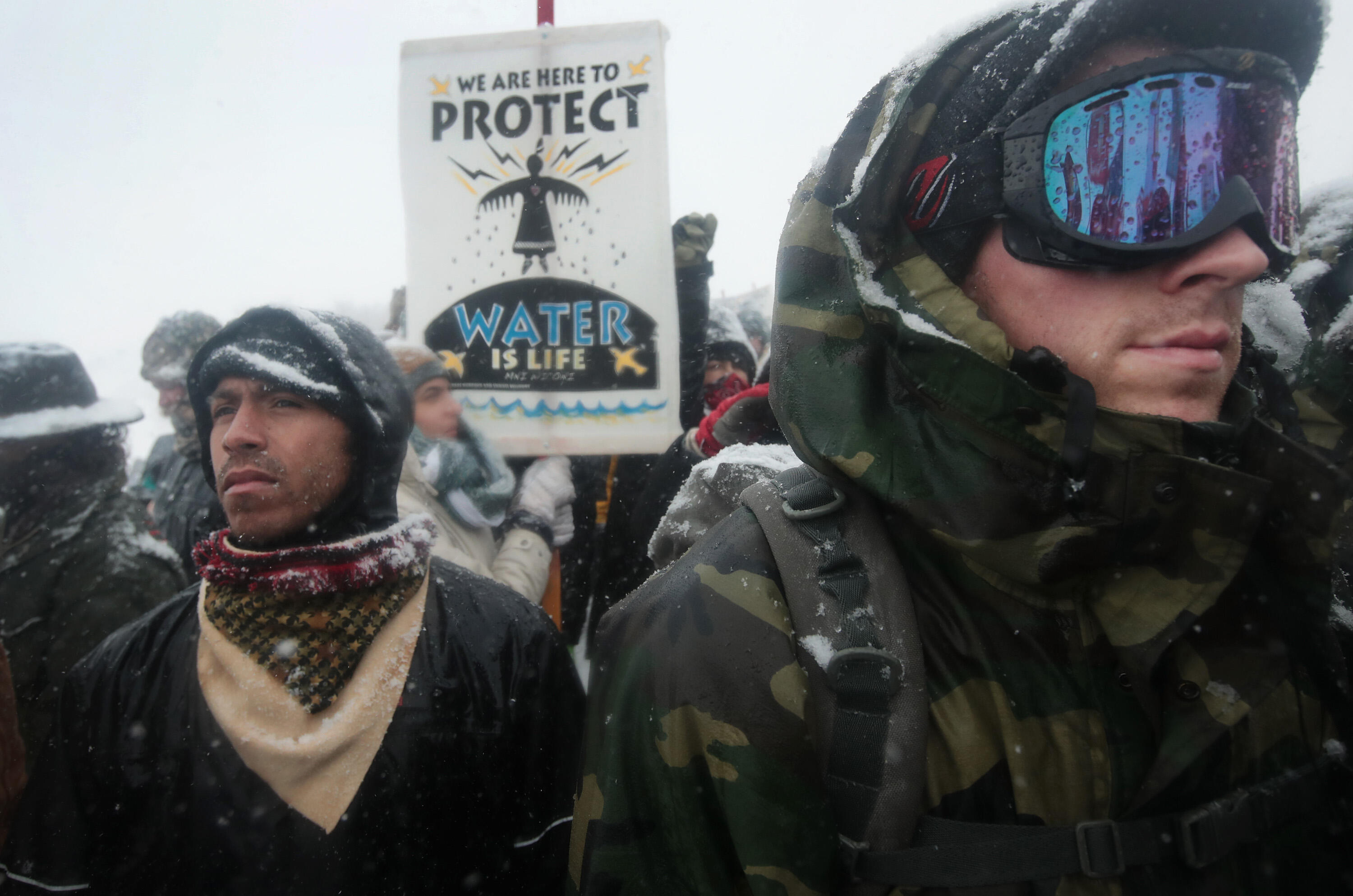 CANNON BALL, ND - DECEMBER 05:  Despite blizzard conditions, military veterans march in support of the