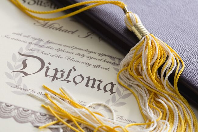 Close-up view of graduation tassel and diploma