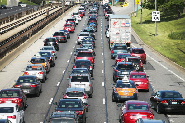 CHICAGO, IL - MAY 23:  Traffic jams up on the Kennedy Expressway leaving the city for the Memorial Day weekend on May 23, 2014 in Chicago, Illinois. AAA forecasts the number of drivers taking to the roads for the holiday will hit a 10-year record. The motor club expects roughly eight in ten Americans to take a road trip during the long weekend.  (Photo by Scott Olson/Getty Images)
