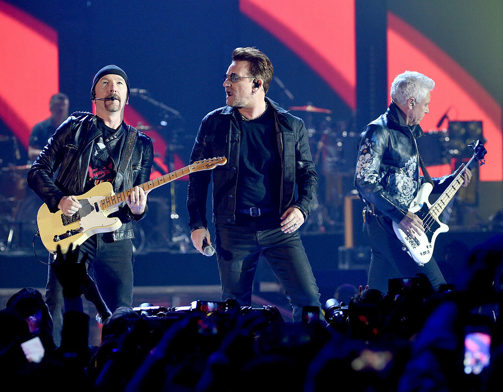 LAS VEGAS, NV - SEPTEMBER 23:  (L-R) Recording artists The Edge, Bono and Adam Clayton of U2 perform onstage at the 2016 iHeartRadio Music Festival at T-Mobile Arena on September 23, 2016 in Las Vegas, Nevada.  (Photo by Kevin Winter/Getty Images)