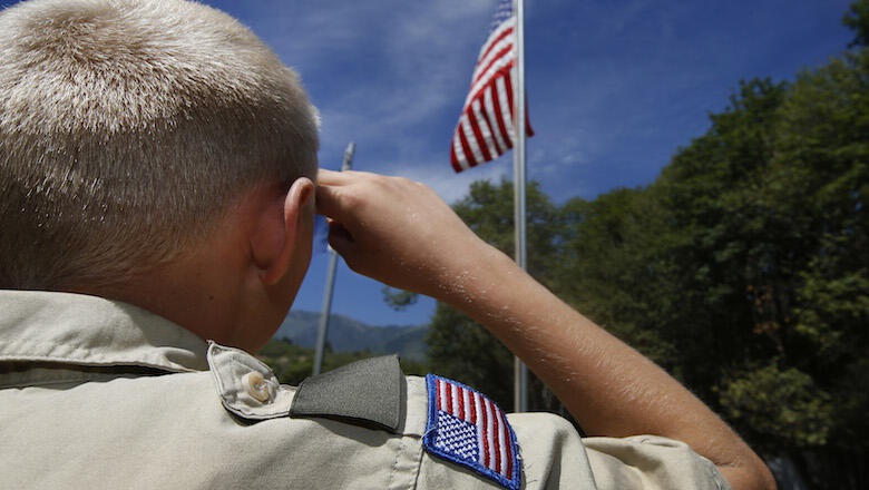 PAYSON, UT - JULY 31: A Boy Scout salutes the American flag at camp Maple Dell on July 31, 2015 outside Payson, Utah. The Mormon Church is considering pulling out of its 102 year old relationship with the Boy Scouts after the Boy Scouts changed it's polic