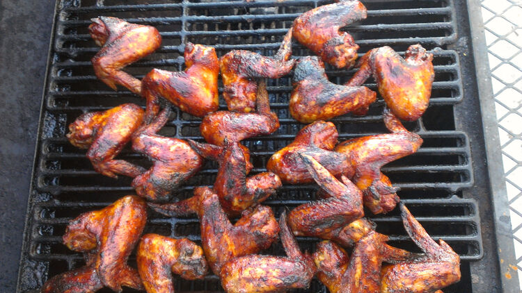 High Angle View Of Chicken Wings On Barbecue Grill