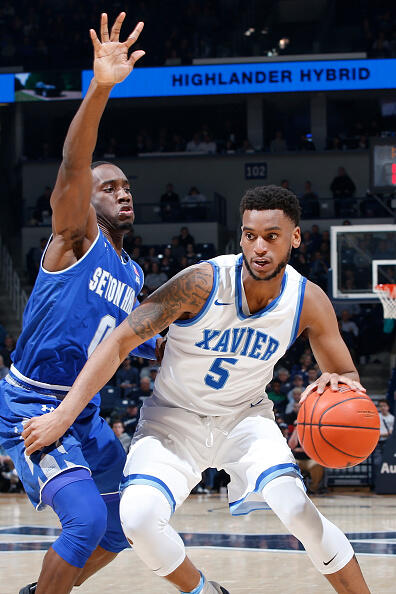 CINCINNATI, OH - FEBRUARY 01: Trevon Bluiett #5 of the Xavier Musketeers handles the ball against Khadeen Carrington #0 of the Seton Hall Pirates in the first half of the game at Cintas Center on February 1, 2017 in Cincinnati, Ohio. (Photo by Joe Robbins/Getty Images)