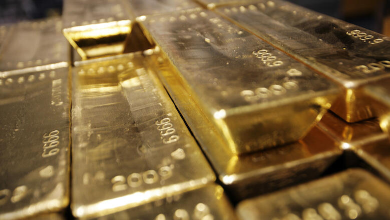 (FILES) This file picture taken on April 6, 2009 shows gold bars stacked at the plant of gold refiner and producer Argor-Heraeus in Mendrisio, in the southern Swiss canton of Ticino. Switzerland's central bank said on January 6, 2014 it lost billions in 2