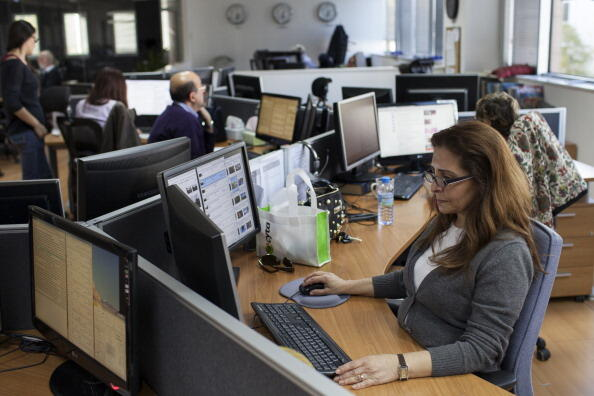 AFP journalist Ghada Faysal from the Arabic desk works on March 14, 2014 at the Middle-East and North Africa headquarters of the global news agency Agence France-Presse (AFP) in the Cypriot capital Nicosia. AFP PHOTO / FLORIAN CHOBLET        (Photo credit