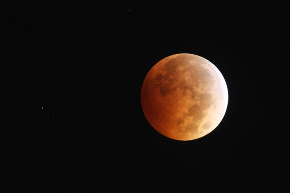 Full Lunar Eclipse Visible As Moon Aligns Into Earth's Shadow