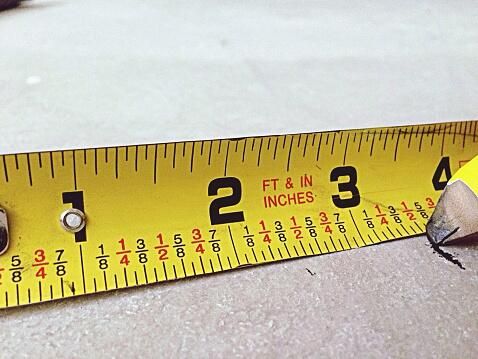 Close-Up Of Yellow Measurement Tape