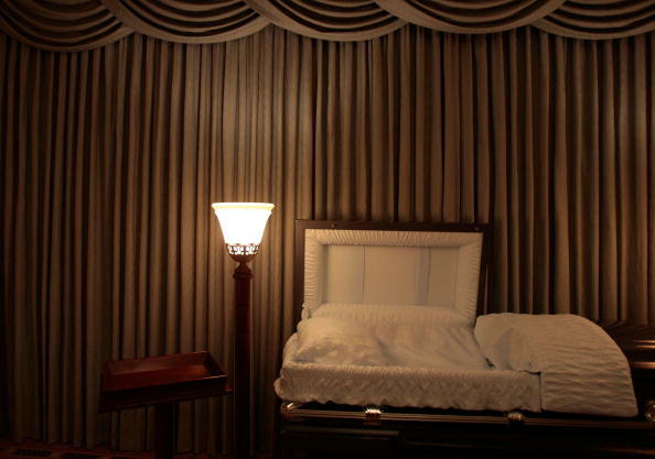 NEW YORK - NOVEMBER 20:  A light illuminates an empty casket in the funeral parlor of Greenwich Village Funeral Home on November 20, 2008 in New York City.  Despite the currently languishing economy, the funeral home world is readying for an upswing natio