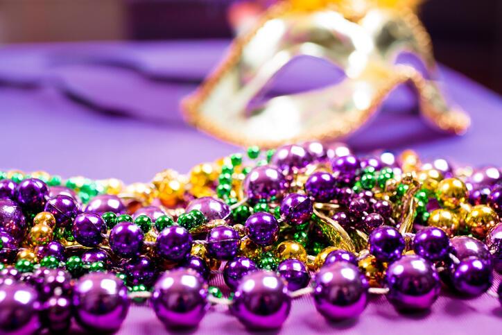 Mardi Gras, Carnival.  Purple, gold, green, mask, beads.