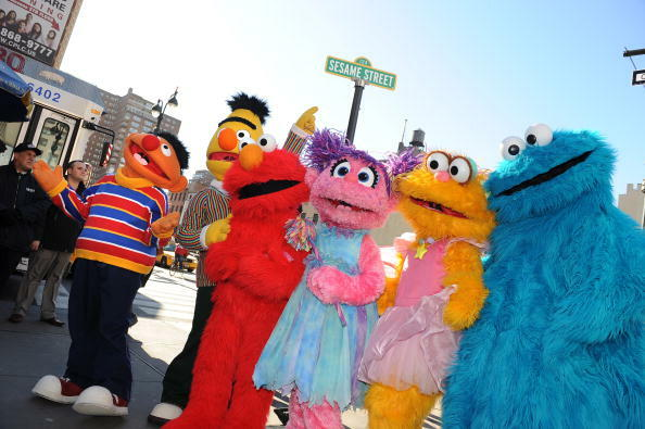 Sesame Street Live charactors (L-R), Ernie, Bert, Elmo, Abby Cadabby, Zoe and Cookie Monster celebrate the renaming of the corner of 31st Street and Eighth Avenue to