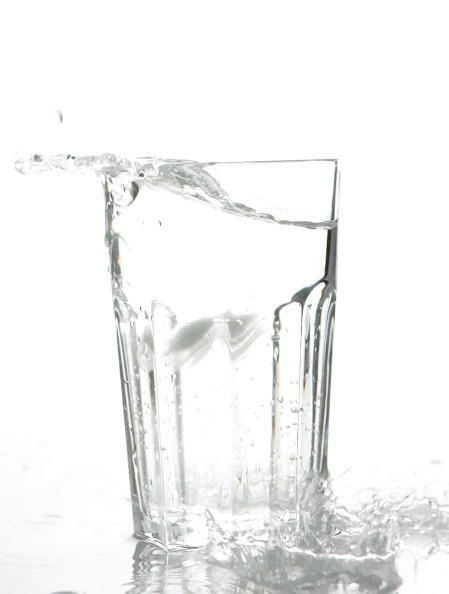BERLIN - JANUARY 14: Ice cubes drop into a glass of water on January 14, 2007 in Berlin, Germany.  (Photo Illustration by Andreas Rentz/Getty Images)