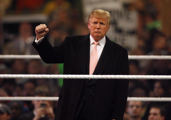 Donald Trump gets the crowd pumped up prior to the start of the WrestleMania 23 at Detroit's Ford Field in Detroit, Michigan on April 1, 2007. (Photo by Leon Halip/WireImage)