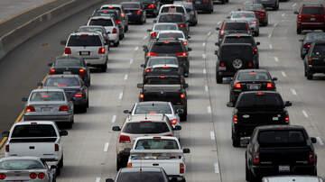 Garrison King - Harrowing Footage of Freeway Sign Falling on a Woman's Car