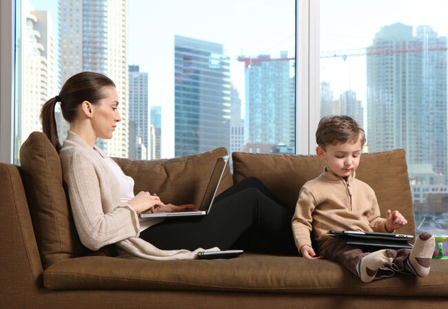 Mom and son on laptops