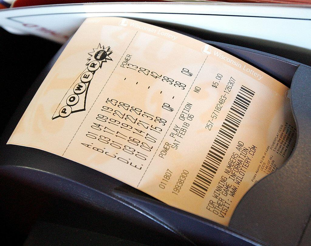 PLEASANT PRAIRIE, WI - FEBRUARY 17:  A freshly printed Powerball ticket is seen at a Citgo gas station February 17, 2006 near the Illinois border in Pleasant Prairie, Wisconsin. The Powerball lottery, having reached a new record high of $365 million, is p