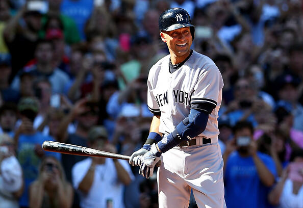 BOSTON, MA - SEPTEMBER 28:  Derek Jeter #2 of the New York Yankees bats against the Boston Red Sox in the first inning during the last game of the season at Fenway Park on September 28, 2014 in Boston, Massachusetts.  (Photo by Elsa/Getty Images)