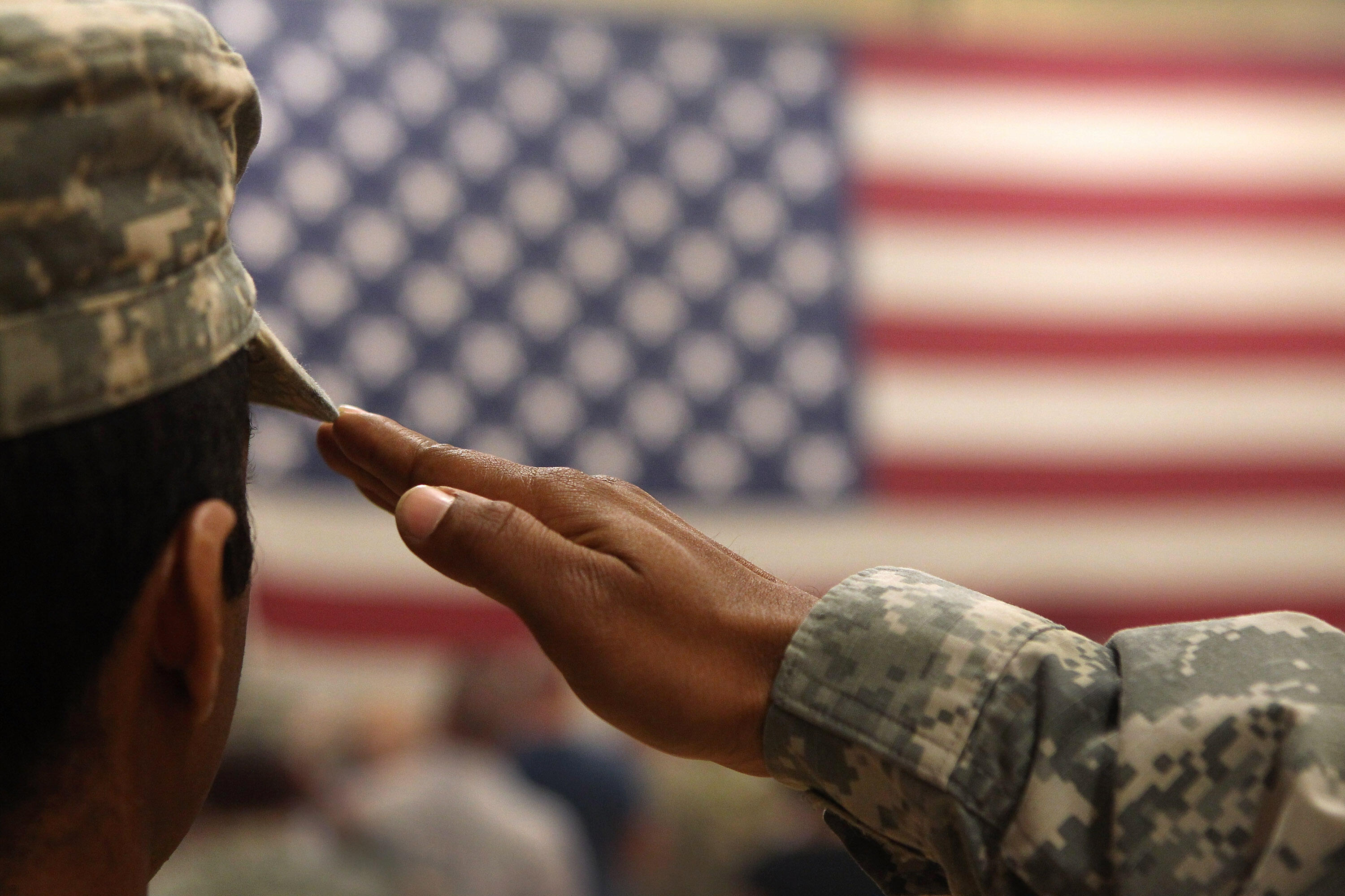 FORT CARSON, CO - JUNE 15:  A soldier salutes the flag during a welcome home ceremony for troops arriving from Afghanistan on June 15, 2011 to Fort Carson, Colorado. More than 500 soldiers from the 1st Brigade Combat Team returned home following a year of