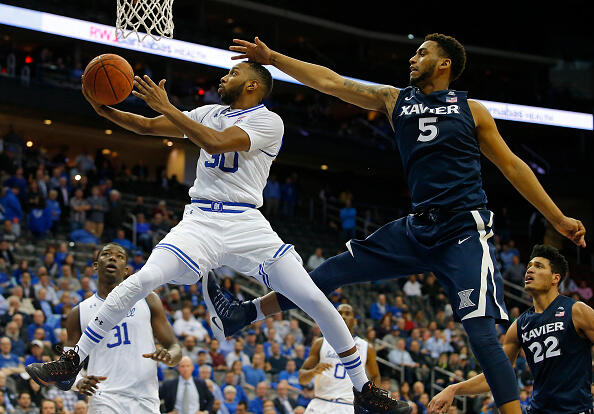 NEWARK, NJ - FEBRUARY 22: Madison Jones #30 of the Seton Hall Pirates attempts a shot as Trevon Bluiett #5 of the Xavier Musketeers defends during the second half of an NCAA college basketball game at Prudential Center on February 22, 2017 in Newark, New Jersey. Seton hall defeated Xavier 71-64. (Photo by Rich Schultz/Getty Images)