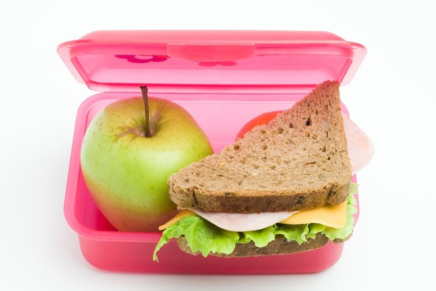 lunch box with sandwich and apple