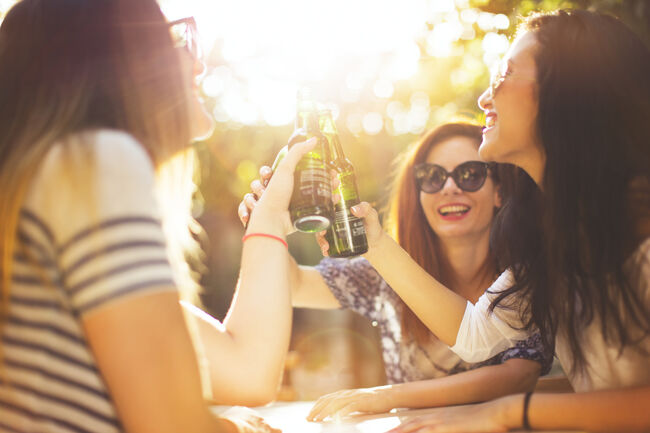 Friends toasting together outdoors