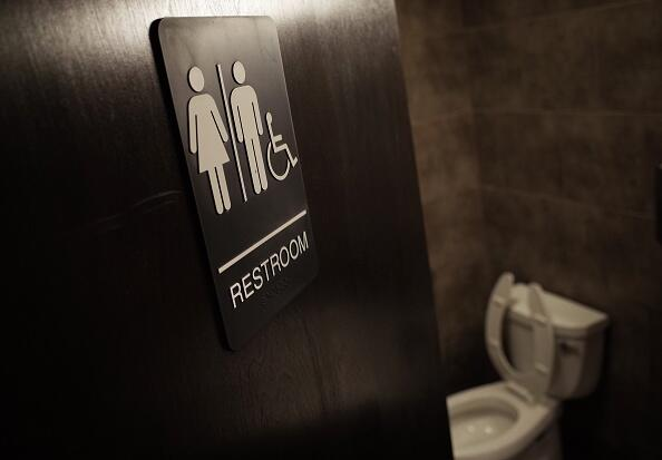 A gender neutral bathroom is seen at a coffee shop in Washington, DC, on May 5, 2016. A heated national debate over access to bathrooms by transgenders is sweeping the United States, with schools and businesses grappling with the issue that has become a hot topic in the presidential campaign. The so-called